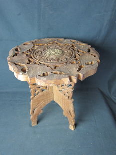 Colonial table with carved flower motifs from India