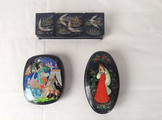Three Russian lacquer boxes with detailed drawing