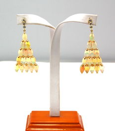 A pair of gold, opal and diamond earrings
