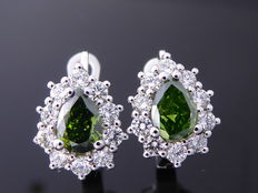 White gold 18 kt stud earrings set with pear-shaped fancy intense green colour diamonds of 1.30 ct in total