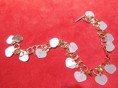 18 kt gold bracelet with natural mother-of-pearl and white gold clasp with diamonds for 0.06 ct, length: 23 cm
