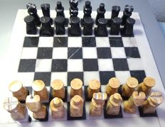 Beautiful chess carved in white and brown agate and fossil stone.