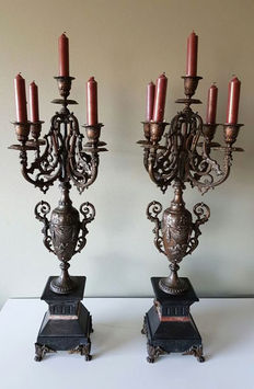 Two large bronze candlesticks on a marble pedestal, ca. 1870