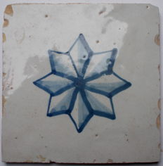 Tile with eight-pointed star