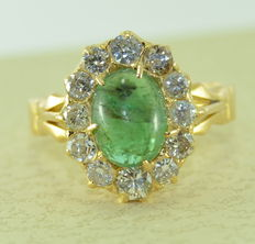 Gold ring set with a natural emerald of 3.20 ct and 12 diamonds of 1.50 ct in total ***no reserve price***