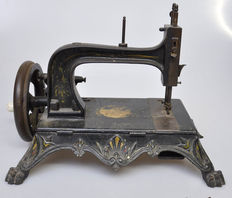 Antique sewing machine from the 19th century.