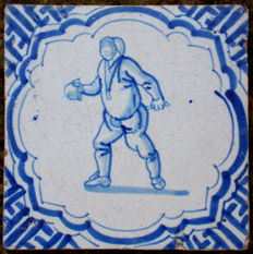 Tile with fencing man