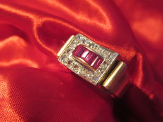 Yellow gold (18 kt) and platinum decorated with 6 rubies and 16 diamonds