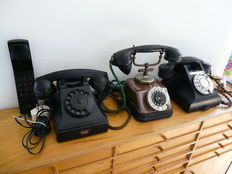 Small collection of 4 very (different) old(er) telephones of bakelite, copper or plastic