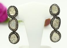Silver earrings set with rough diamonds