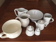 Collection white/cream porcelain jugs and bowls.