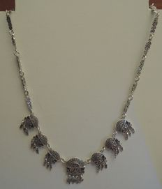 Silver necklace with Inca pattern.