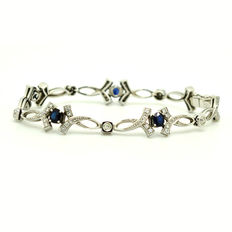 Exclusive 18 kt gold bracelet with sapphires and brilliant cut diamonds, 2.65 ct in total. Measurement: 18 cm