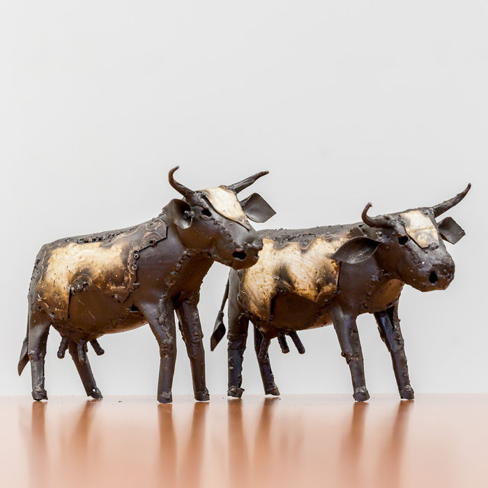Two cows made of metal