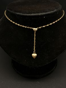 14  kt yellow gold necklace with two gold hearts.