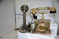 Pair of phones one in stone and one in metal, both working