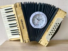Original antique Hohner Student II Accordion turned into a wall clock.