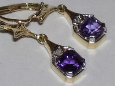 14 karat yellow gold dangle earrings with amethysts and diamonds