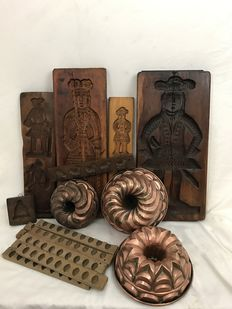 Six wooden cookie moulds, eight sugar moulds and three red copper baking moulds, ca. 1900, The Netherlands