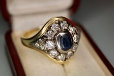 Around 1900, antique, solid, 14 kt gold ring set with sapphire, approx. 1 ct and 10 large, natural diamonds, approx. 1 ct and 6 smaller diamonds, more than 2 ct in total.