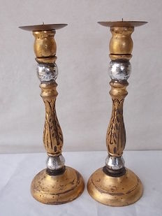 Pair of candlesticks in wood, silver and gold, Italy, 20th century