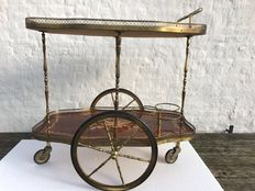 Antique copper serving trolley of copper and beauifully painted mahogany tiers, including bottle holder. In very good condition.