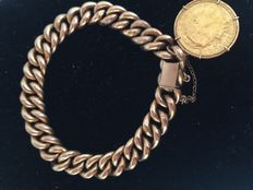 Gold (18 kt) bracelet with 22 kt coin.