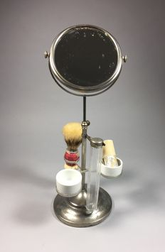 Shaving mirror with accessories