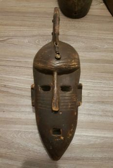Old Dogon hunter Mask Wood Carved - adorned with pendant shell