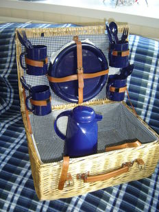 Nice big reed picnic basket complete for 4 people and an accompanying thermos flask.