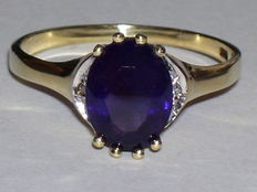 14 karat gold ring with an amethyst and 2 diamonds