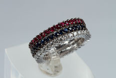 Three rings in white gold with diamonds, rubies, and sapphires