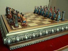 Chess with figures made of lead. Polychrome marble powder box-board