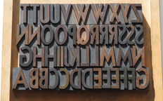 Set of antique wooden letters (printing letters, bill letters) complete with alphabet and many additional letters.
