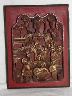 Red lacquered wood panel, scenes with warriors – China – Early 20th century