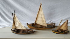 Three wooden sailing / rowing boats