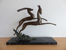 Copper or bronze stylized statue of a deer