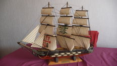 Old model ship with three masts
