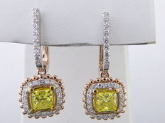 Earrings in 18 kt bicoloured gold - set with two fancy intense yellow coloured princess cut diamonds & 56 brilliant cut diamonds with a total of 1.60 ct
