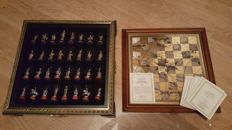 Tin chess set with gold-plated and silver-plated chess pieces (certificate), Franklin Mint