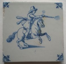 Antique tile with shooting horseman
