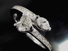 White gold exclusive ring with heart-shaped and marquise cut diamond & with 22 cut diamonds of 0.90 ct in total