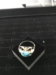 Gold women's ring with turquoise