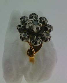 Gold, silver, and diamond ring