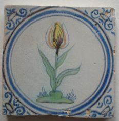 Antique tile with multicoloured flower. (Rare type)