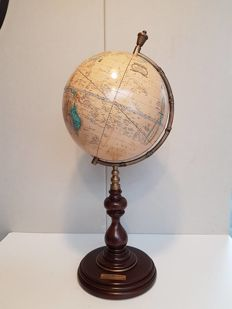 Large globe on a tall wooden pedestal