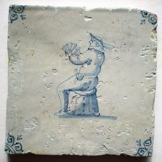 Antique tile with card player (rare scene)