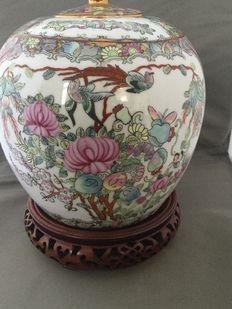 Large Chinese jar on a wooden pedestal