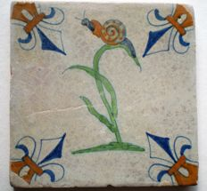 Antique tile with polychrome flower with snail (rare)