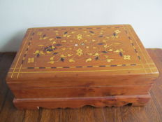 Beautiful wooden storage chest with wooden inlay